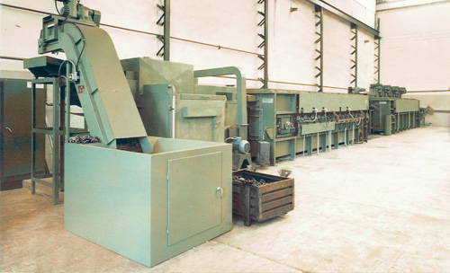 Continuous quench and tempering furnace